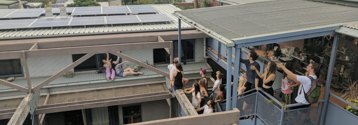 Students pointing at rooftop solar