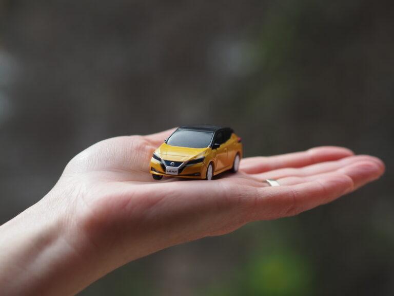 Miniature EV in palm of hand